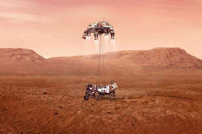 Ilustração mostra a chegada do veículo rover no solo marciano (Foto: Nasa)